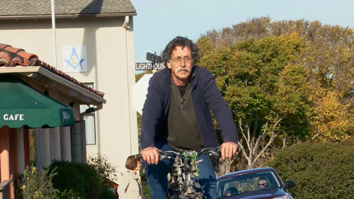 Bob Pacelli riding his bike through Pacific Grove